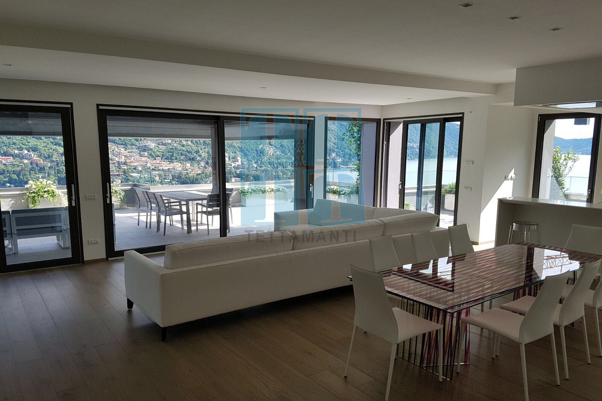 Soggiorno e sala da pranzo con ampie vetrate a vista - Tettamanti ...
