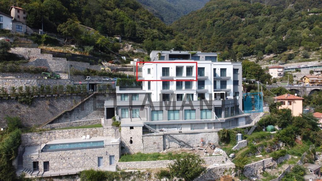 carate urio condominio nuovo appartamento vista lago in vendita